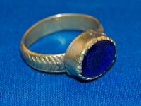 A large 18th/19th Century pleasant Islamic silver gents finger ring with a blue glass / gem stone set bezel.